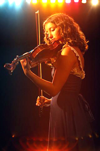 Girl Playing Violin on Stage